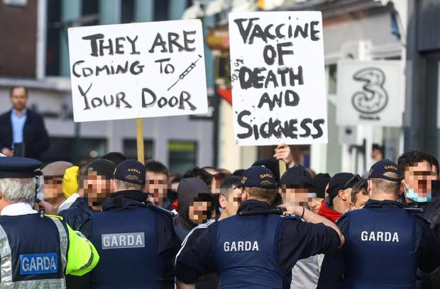 Gardaí form a line on Grafton Street after disorder erupted at a planned anti-lockdown gathering in Dublin city centre on Saturday.