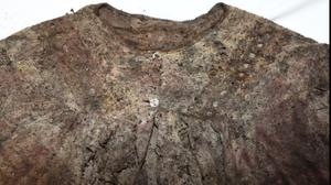 An item of clothing was also recovered which is described as a white nightdress type garment (image attached)