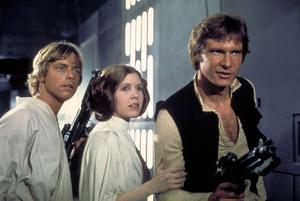 """Actors, from left, Mark Hamill as Luke Skywalker, Carrie Fisher as Princess Leia and Harrison Ford as Han Solo, appear in a scene from Lucasfilm's """"Star Wars: Episode IV, A New Hope"""""""