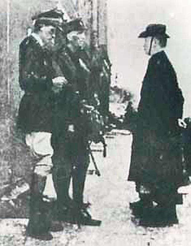 Padraig Pearse surrenders to British forces after the 1916 Rising