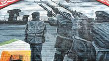 True colours: An IRA mural in west Belfast in 2006 – Sinn Féin is the only political party among Ireland's peer countries to have a private army behind it. Photo: Paul Faith/PA