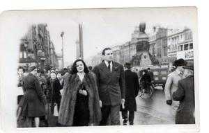 Jack Doyle with Nancy Keogh walking over O'Connell Street