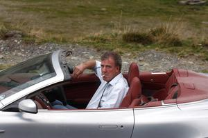 "British television BBC presenter of motor show ""Top Gear"" Jeremy Clarkson is pictured while he drives an Aston Martin car on Transfagarasan road close to Sibiu city, 300 km northwest from Bucharest"