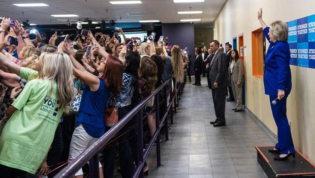 Hillary Clinton spent tens of millions of dollars employing a team of over 100 people, targeting millennials with her message on Facebook - Hillary poses while her team take selfies
