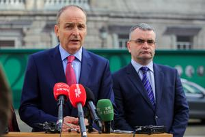 Falling: Fianna Fáil leader Micheál Martin (left) and deputy leader Dara Calleary may be in government, but their party's popularity is tumbling. PHOTO: GARETH CHANEY COLLINS