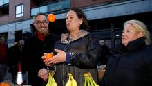 Party tricks: Sinn Féin leader Mary Lou McDonald juggles with oranges in Dublin yesterday as colleagues look on. Photo: Phil Noble/Reuters