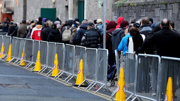 Queueing for food parcels: Up to 40pc of the population could be in poverty without social protection payments. Photo: Gerry Mooney