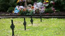 BURIED SECRETS: Teddies and toys along with flower bouquets sit at the 'Little Angels' memorial plot in the grounds of Bessborough House in Blackrock, Cork. Photo: Photocall Ireland