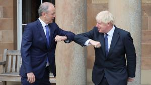 UK prime minister Boris Johnson and Taoiseach Micheal Martin greet each other with an elbow bump at Hillsborough Castle in Belfast