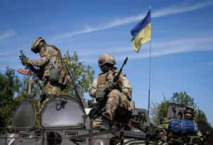 Members of the Ukraine military special forces on an armoured vehicle near Kramatorsk in Ukraine last week