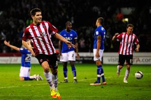 A LIFE OF TWO HALVES: The future seems very different for Ched Evans, seen here (left) in Sheffield United colours having celebrated a goal, now that clubs no longer seem willing to sign