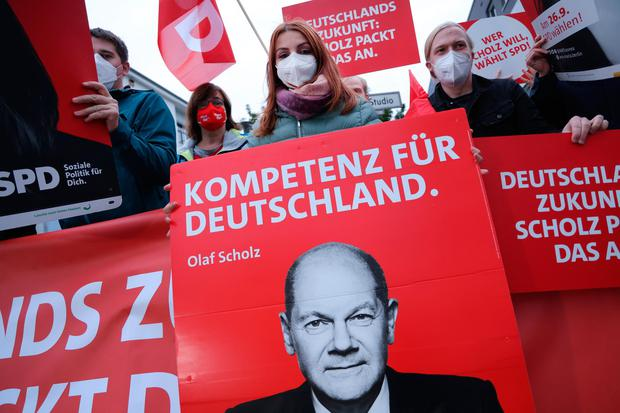 Supporters of Olaf Scholz wait for him ahead of the final televised election debate this week.