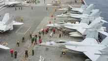 US Navy FA-18 Hornets park on the flight deck of the USS George Washington on Thursday, during the annual exercise  at sea