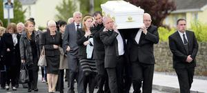 THE HARDEST WALK: Family and friends help the Heffernans say goodbye to their son Liam, 5. His dad Tony is front right, in glasses. Photo: Domnick Walsh