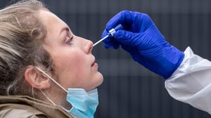 A woman getting a nasal swab at a testing centre in Cologne, Germany