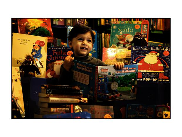 Ahmed Kilinc with a selection of books in a Dublin bookshop