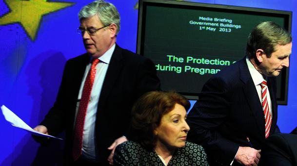 Tanaiste Eamon Gilmore,TD makes his way to the rostrum after Taoiseach Enda Kenny,TD had spoke at the media briefing at Government Buildings following the publication of The Protection of Life during Pregnancy Bill 2013 . Pic Tom Burke 1/5/13