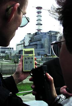 PARTICIPANTS OF INTERNATIONAL CONFERENCE ON BATTLING CHERNOBYL AFTERMATH CHECK RADIATION LEVEL IN CHERNOBYL...Participants of the International conference on battling the Chernobyl disaster aftermath check the radiation level outside the concrete sarcophagus housing Chernobyl nuclear power plant's fourth reactor, April 21, 2001. Fifteen years ago the plant witnessed the world's worct civil nuclear disaster, when the power unit number four exploded during a test of turbine's behaviour in the event of a loss of power from the reactor. REUTERS/Gleb Garanich...I