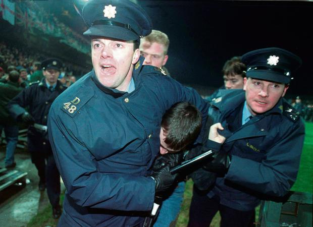 An English fan is restrained by gardai after rioting at the Republic of Ireland v England friendly at Lansdowne Road in 1995