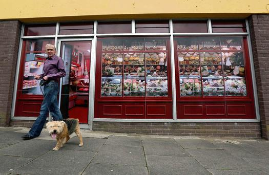 Graphics pasted to the outside of derelict buildings to make it look like a working butchers shop in the village of Belcoo