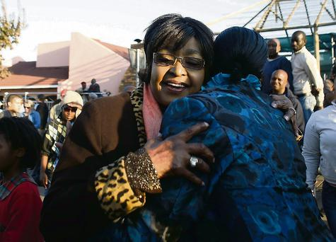 Winnie Madikizela-Mandela embraces a wellwisher. The children from Mr Mandela's first marriage were sidelined for years by Ms Madikizela-Mandela