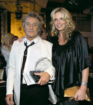 Rod and wife Penny Lancaster: If I was a woman, I'd say – 'Are you taking me out looking like that, toe rag?'