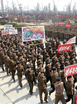 Troops in North Korea attend an anti-US rally. Groupthink is simply a way of washing ones hands of personal responsibility.