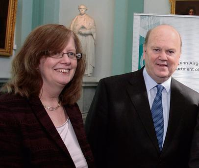 ALL SMILES AND STILL AT THE TOP: Ann Nolan, with Finance Minister Michael Noonan.
