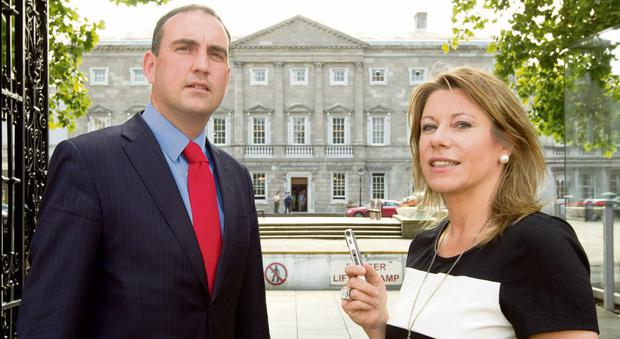 'THE PUBLIC ARE ENTITLED TO CLOSURE': Carol Hunt and Senator Marc MacSharry outside Leinster House.