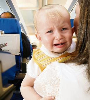 Many families are familiar with the angry glances from fellow passengers when their children start crying on a flight