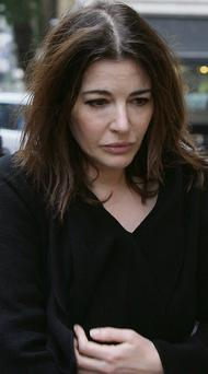 Nigella Lawson learned that her husband of 10 years, Charles Saatchi, was to divorce her via a newspaper