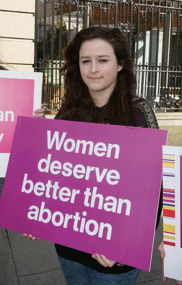 Pro-life and pro-choice protesters express their views