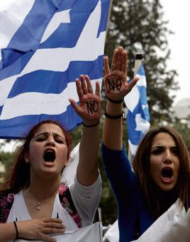 ANGER: Students in Cyprus, where large bank account holders suffered big losses, protest at tough austerity measures