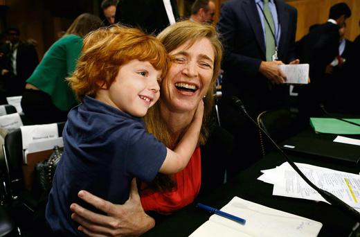 Samantha Power is hugged by her son Declan (5) after he sat through a hearing on her nomination for the role of US ambassador to the United Nations.