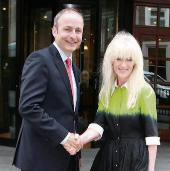 Fianna Fail Leader Michael Martin TD pictured with new party member Meath County Council member Jenny McHugh