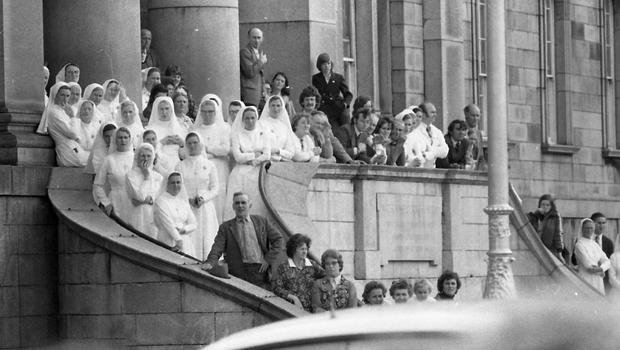 PRO-ETHOS: Nuns and staff at the Mater Hospital during the funeral of Eamon de Valera in 1975 when church and State were closely aligned 75 . STATE FUNERAL FOR DEV .. Nuns and staff at the Mater Hospital awaiting the funeral cortege of the late President Eamonn de Valera who was buried in Glasnevin cemetery 3rd.Sept 1975 Pic Donal Doherty INDP PIC indo pic Scanned from the NPA archives.