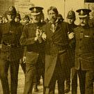 Union leader 'Big' Jim Larkin is led away by police after his arrest during the Dublin Lockout