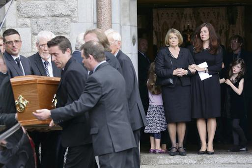 Seamus Heany's widow, Marie looks on as the remains are carried from church pictured at the Church of the Sacred Heart, Donnybrook