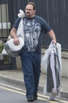 Right, Foley leaves the Midlands Prison with his belongings.