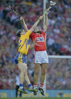 Clare and Cork players vie for the sliotar during the replay and inset, the 'Guardian' editorial praising the game