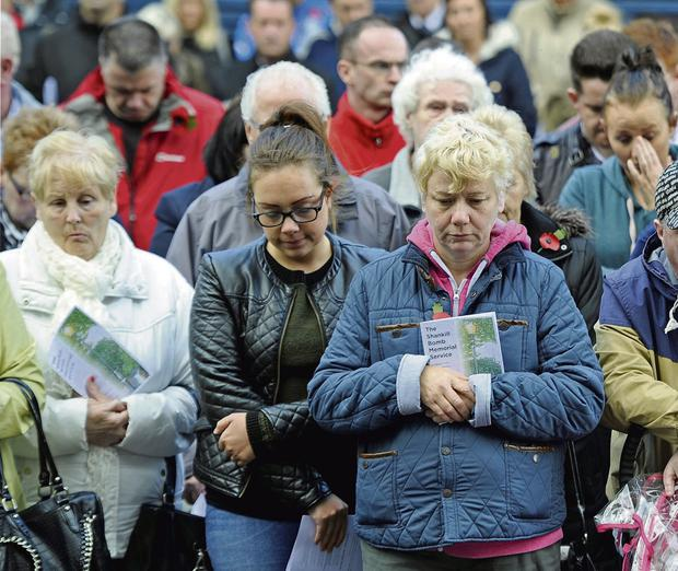 COMMON BOND: Left, hundreds attend a service in West Kirk to mark the 20th anniversary of the Shankill bombing