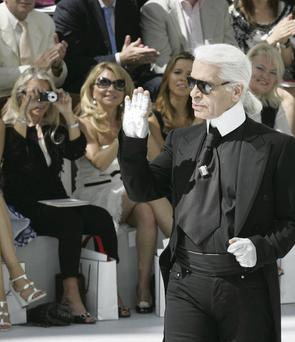 Catwalk king: Lagerfeld faces legal action over 'fat bias'