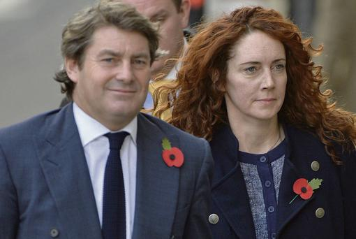 Hacking trial: Former News International chief executive Rebekah Brooks and her husband Charlie at the Old Bailey in London last Thursday on various charges related to hacking, illegal payments to officials and hindering police investigations