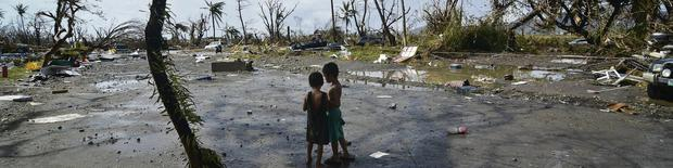 Two children amid the devastation left by Haiyan