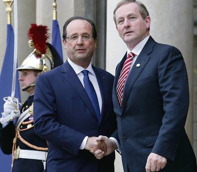 Francois Hollande greets Enda Kenny at the steps of the Elysee Palace in Paris. 'Not just swanning around'