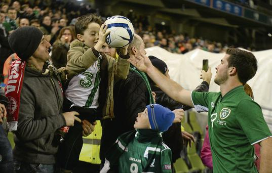 Shane Long hands the match ball to his nephew Eamon Long (7) after the game last night.