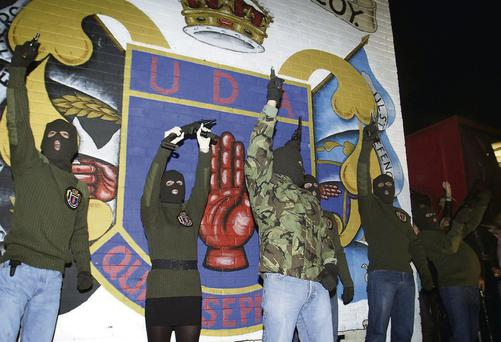 Members of the Ulster Freedom Fighters on the Shankill Road, Belfast, as Ulster Defence Association leaders decommissioned all weapons under its control, in January 2010. Paul Faith/PA
