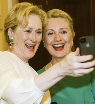 HOW WE LAUGHED! Actress Meryl Streep (on the left, although, to be fair, it's difficult to tell) with Hillary Clinton indulge in a spot of selfie-ing. Photo: Kevin Wolf