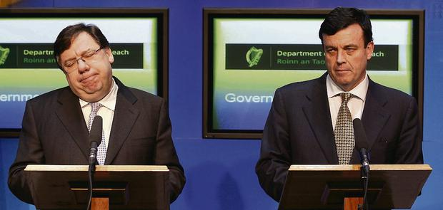 Double act: Then Taoiseach Brian Cowen and then finance minister Brian Lenihan speak to the media on November 21, 2010