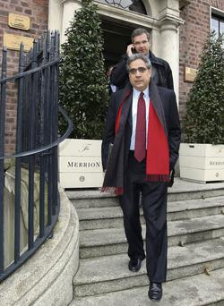 Face of the new masters: IMF boss Ajai Chopra (left) leaves the Merrion Hotel